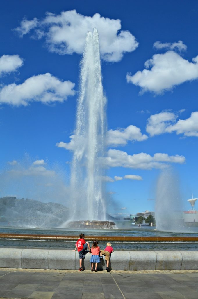 Kids climbing in a Pittsburgh fountain.