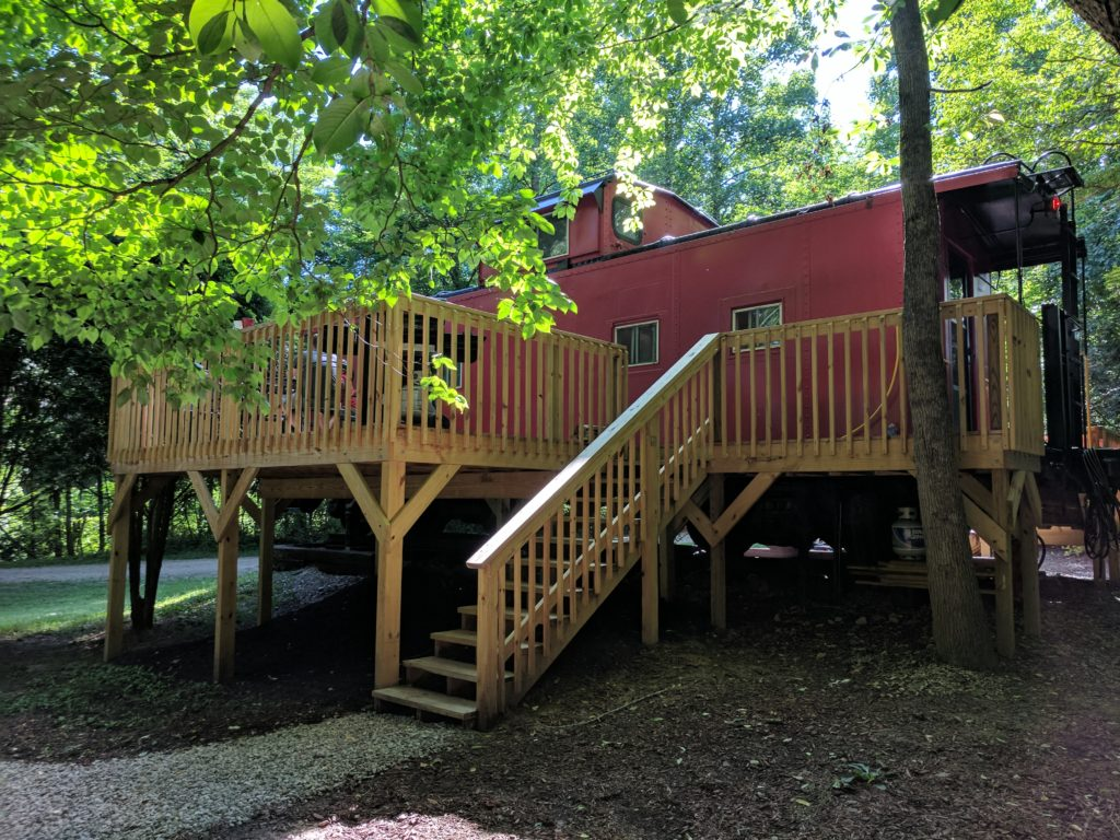 Hocking Hills Caboose- Unique Ohio Lodging- a full deck to barbecue and enjoy time outside.