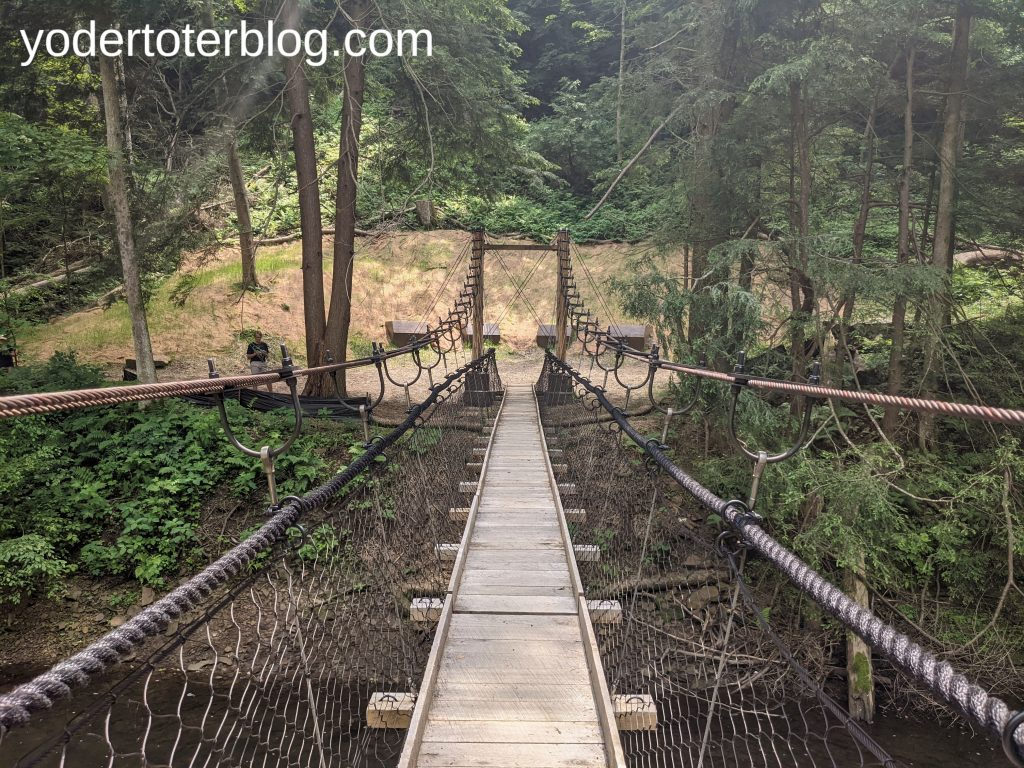 Gorge Overlook Trail swinging bridge - Mohican State Park, Ohio  - this newly reopened trail is great for adventure seekers looking for a difficult hiking trail in Ohio.